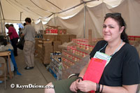 Volunteer Rebecca Guenzel from Philadelphia, PA checks IDs to make sure only local residents receive donated merchandise at the Free Store at Emergency Communities in St. Bernard Parish, LA. Emergency Communities was formed after Hurricane Katrina to fill some of the service gaps left by traditional disaster response agencies. Emergency Communities set up a community kitchen, distribution center and volunteer encampment in St. Bernard Parrish near the border with Orleans Parish. In June, Emergency Communities will move their operation down to Violet, about 6 miles away.