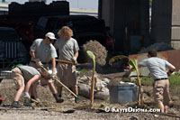 Americorp volunteers, Elizabeth Topham (Philadelphia), Joseph Fogarty (Long Island, NY), Peter Mills, (Shoreview, MN) and Eric Crawford (Philadelphia) work in the Bioremediation Garden at Common Ground Relief's Midtown Operation Center at Art Egg in New Orleans. In addition to the Bioremediation Gardens, Common Ground educates residents and provides them plants to help reduce toxins in the soil.
