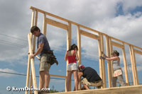 Volunteers from Texas Roadhouse work for Habitat for Humanity at the Musicians' village in the Upper 9th Ward of New Orleans.